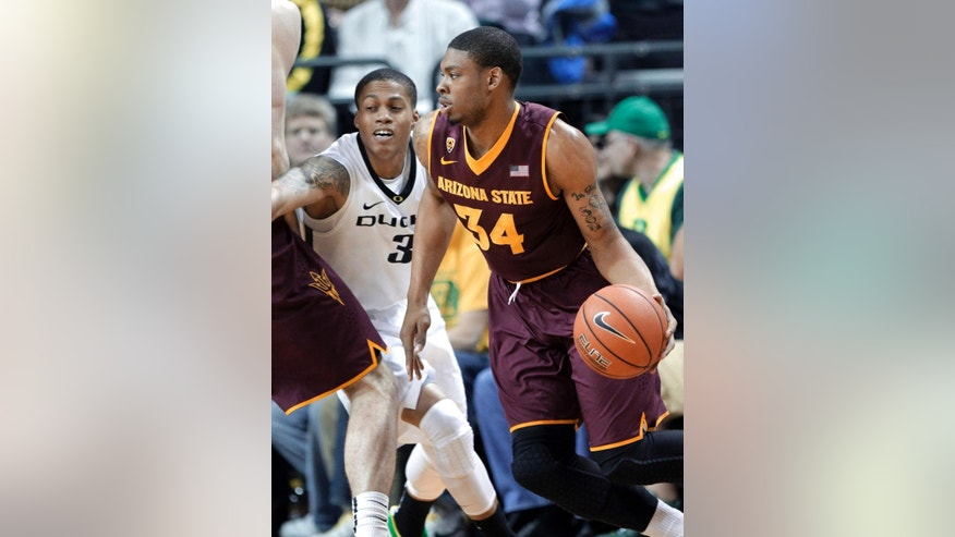 Arizona State guard Jermaine Marshall, right, drives on Oregon guard Joseph Young during the first half of an NCAA college basketball game in Eugene, Ore., Tuesday, March 4, 2014. (AP Photo/Don Ryan)