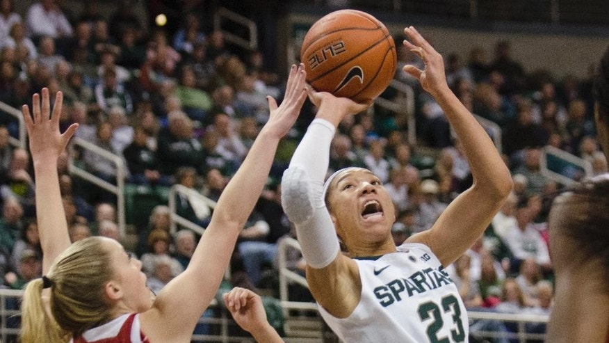 Michigan State's Aerial Powers, right, shoots over Indiana's Taylor Agler during an NCAA college basketball game Sunday, March 2, 2014, in East Lansing, Mich. (AP Photo/The Saginaw News, Tim Goessman) LOCAL TV OUT  LOCAL INTERNET OUT