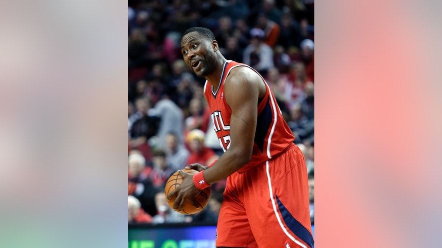 Atlanta Hawks center Elton Brand yells to a teammate from the top of the key during the first half of an NBA basketball game against the Portland Trail Blazers in Portland, Ore., Wednesday, March 5, 2014. (AP Photo/Don Ryan)