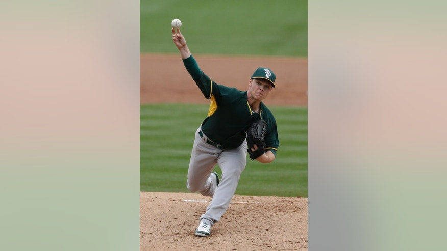 Oakland Athletics starting pitcher Sonny Gray delivers to an Arizona Diamondbacks batter during the first inning of a spring exhibition baseball game on Thursday, March 6, 2014, in Scottsdale, Ariz. (AP Photo/Gregory Bull)