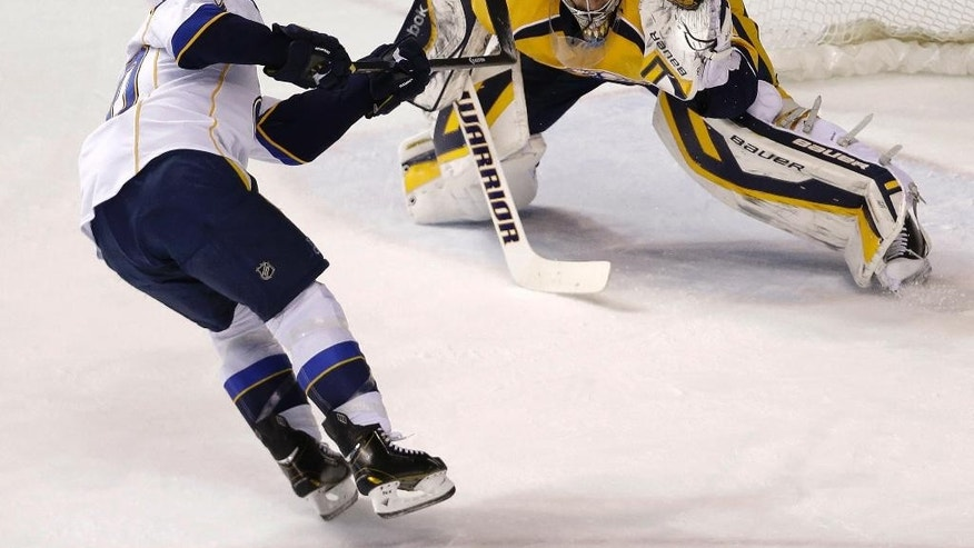 Nashville Predators goalie Pekka Rinne (35), of Finland, gloves a penalty shot attempt by St. Louis Blues left wing Alexander Steen (20) in the second period of an NHL hockey game Thursday, March 6, 2014, in Nashville, Tenn. (AP Photo/Mark Humphrey)