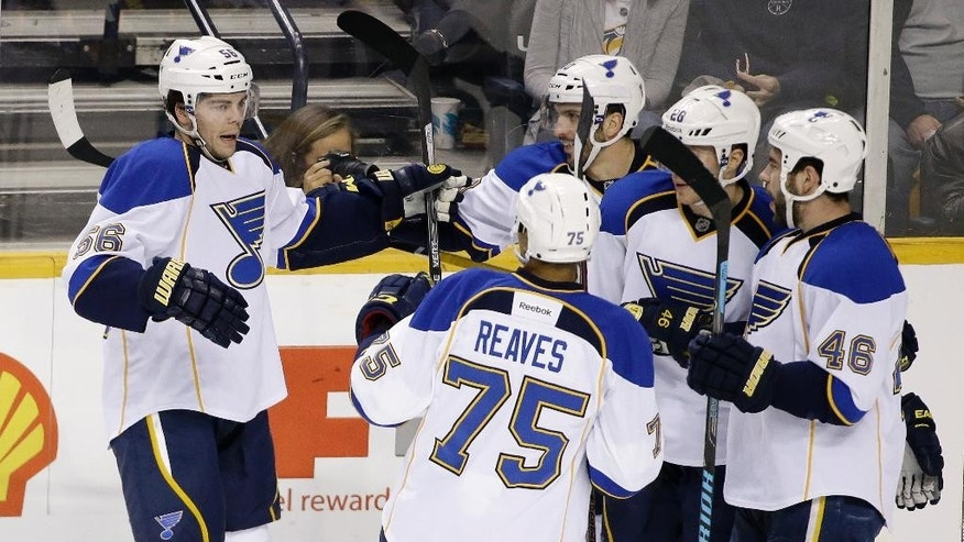 St. Louis Blues left wing Magnus Paajarvi (56), of Sweden, celebrates with teammates after scoring against the Nashville Predators in the second period of an NHL hockey game Thursday, March 6, 2014, in Nashville, Tenn. (AP Photo/Mark Humphrey)