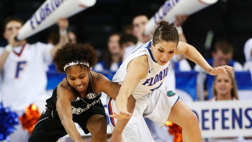 Mississippi State guard Katia May, left, and Florida guard Carlie Needles chase down a loose ball in the first half of a second-round women's Southeastern Conference tournament NCAA college basketball game Thursday, March 6, 2014, in Duluth, Ga.  (AP Photo/John Bazemore)