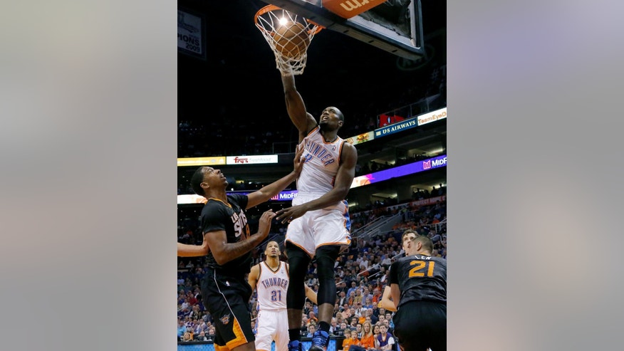 Oklahoma City Thunder forward Serge Ibaka, of the Republic of the Congo, shoots over Phoenix Suns' Channing Frye, left, during the first half of an NBA basketball game on Thursday, March 6, 2014, in Phoenix. (AP Photo/Matt York)