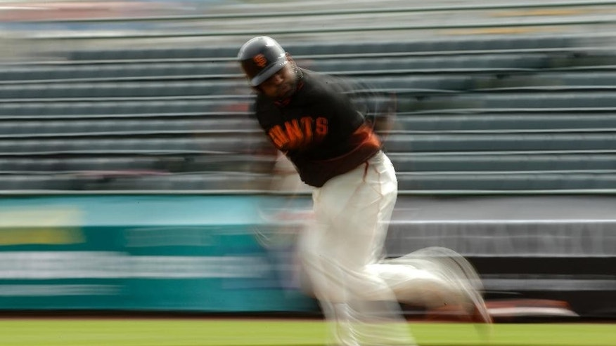 San Francisco Giants third baseman Pablo Sandoval runs the bases before a spring training baseball game against the Cincinnati Reds in Scottsdale, Ariz., Thursday, March 6, 2014. (AP Photo/Chris Carlson)