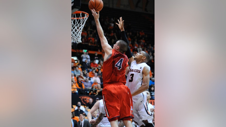 Arizona's TJ McConnell (4) shoots against Oregon State's Hallice Cooke (3) during the first half of an NCAA college basketball game in Corvallis, Ore., Wednesday March 5, 2014.  (AP Photo/Greg Wahl-Stephens)