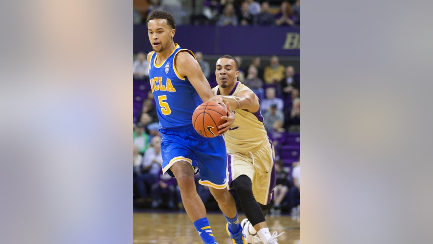 Washington's Andrew Andrews, right, steals the ball from UCLA's Kyle Anderson in first half of an NCAA college basketball game on Thursday, March 6, 2014, in Seattle. (AP Photo/Stephen Brashear)