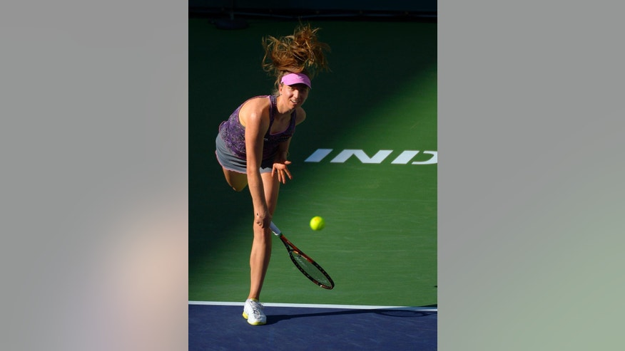 Mona Barthel, of Germany, serves to Francesca Schiavone, of Italy, during a match at the BNP Paribas Open tennis tournament, Thursday, March 6, 2014, in Indian Wells, Calif. (AP Photo/Mark J. Terrill)