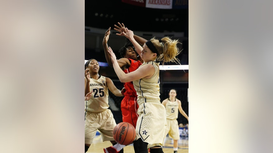 Georgia guard/forward Krista Donald (15) and Vanderbilt guard Kylee Smith (23), right, battle for a rebound in the first half of a second-round women's Southeastern Conference tournament NCAA college basketball game Thursday, March 6, 2014, in Duluth, Ga.  (AP Photo/John Bazemore)
