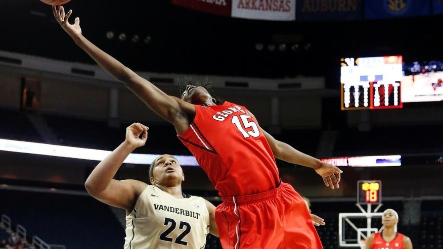 Georgia's Krista Donald (15) reaches for a high pass as Vanderbilt forward Marqu'es Webb (22) defends in the first half of a second-round women's Southeastern Conference tournament NCAA college basketball game Thursday, March 6, 2014, in Duluth, Ga. (AP Photo/John Bazemore)