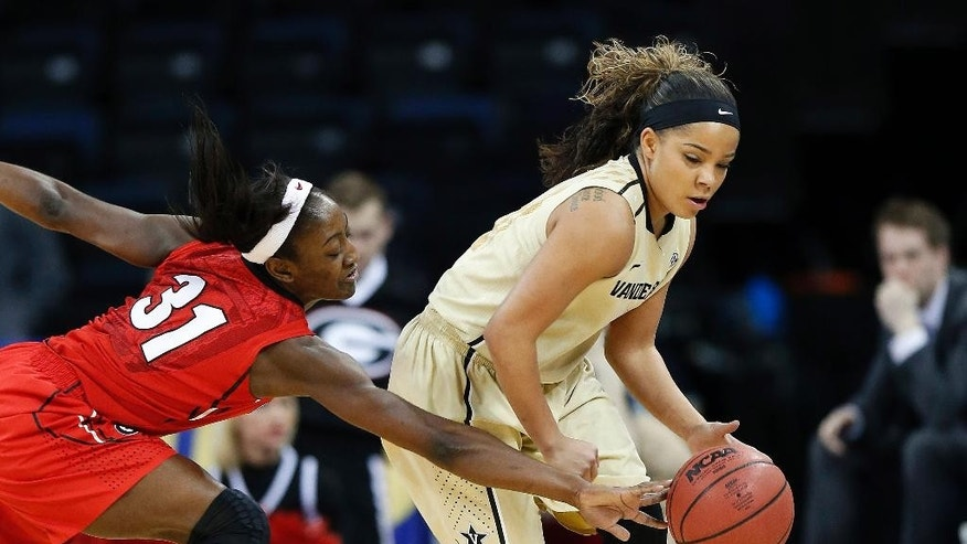 Georgia guard Erika Ford (31) reaches to steal the ball from Vanderbilt guard Jasmine Lister in the first half of a second-round women's Southeastern Conference tournament NCAA college basketball game Thursday, March 6, 2014, in Duluth, Ga. (AP Photo/John Bazemore)