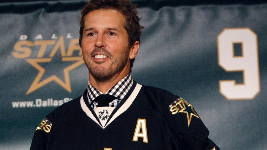 FILE - In this Sept. 23, 2011, file photo, NHL hockey player Mike Modano wears a Dallas Stars jersey during a news conference announcing his retirement in Dallas. Modano had several tearful farewells as his playing days wound down. The guy who made hockey cool in Dallas figures he'll get emotional again for the final ceremony: retiring his iconic No. 9 during the Stars' game against Minnesota on Saturday, March 8. (AP Photo/LM Otero, File)