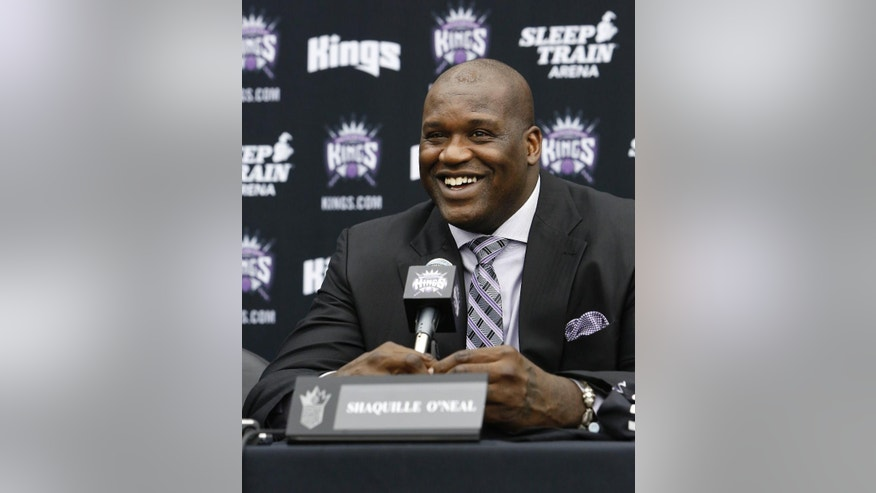 "FILE - In this Sept. 24, 2013 file photo, Shaquille O'Neal smiles during a news conference where he was welcomed as one of the new minority owners of the Sacramento Kings in Sacramento, Calif. O'Neal said in an interview on Monday, March 3, 2014, that he's seeking redemption for ""Shaq Fu,"" his infamous 2-D brawler originally released in 1994 that's now considered to be among the worst games ever made. The four-time NBA champion is launching a crowdfunding campaign to create a ""Shaq Fu"" follow-up called ""Shaq Fu: A Legend Reborn."" (AP Photo/Rich Pedroncelli, file)"