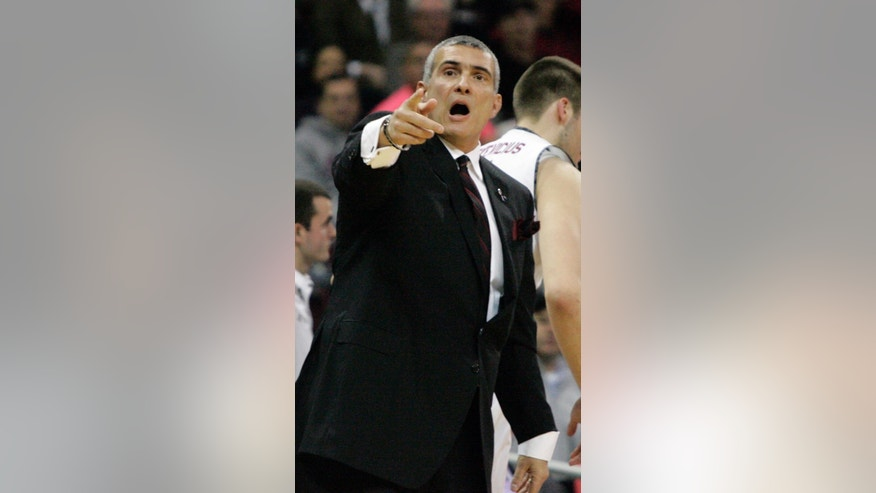 South Carolina's coach Frank Martin talks to his players during the first half of their NCAA college basketball game against Florida Tuesday, March 4, 2014, in Columbia, S.C.(AP Photo/Mary Ann Chastain)