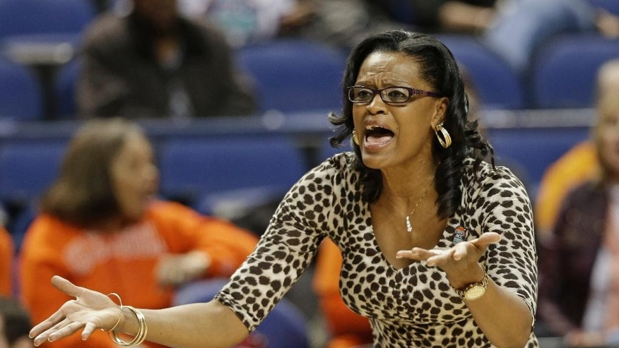 Clemson head coach Audra Smith reacts to a call during the second half of an NCAA college basketball game against Syracuse at the Atlantic Coast Conference tournament in Greensboro, N.C., Thursday, March 6, 2014. Syracuse won 63-53. (AP Photo/Chuck Burton)