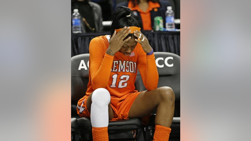 Clemson's Quinyotta Pettaway (12) reacts after fouling out during the second half of an NCAA college basketball game against Syracuse at the Atlantic Coast Conference tournament in Greensboro, N.C., Thursday, March 6, 2014. Syracuse won 63-53. (AP Photo/Chuck Burton)