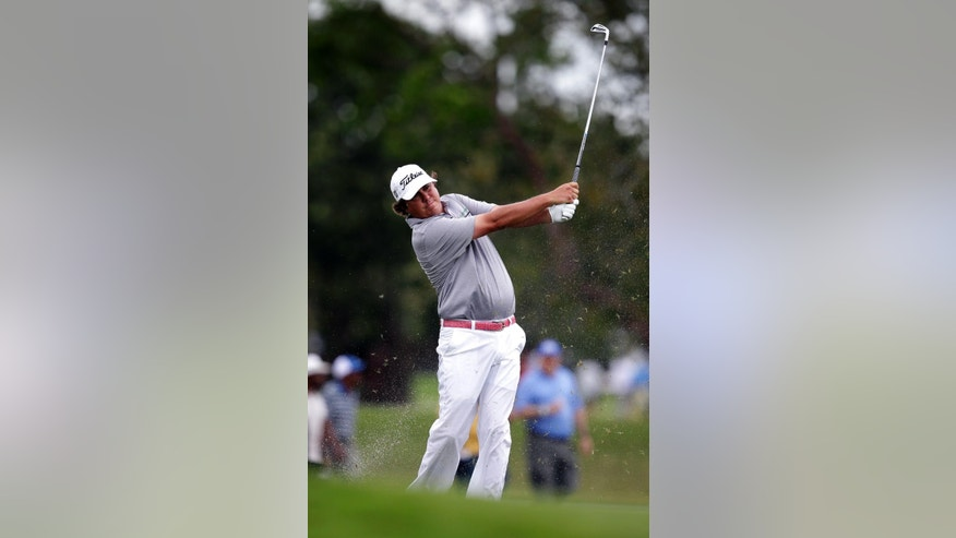 Jason Dufner hits from the fairway on the 17th hole during the first round of the Cadillac Championship golf tournament Thursday, March 6, 2014, in Doral, Fla. (AP Photo/Wilfredo Lee)