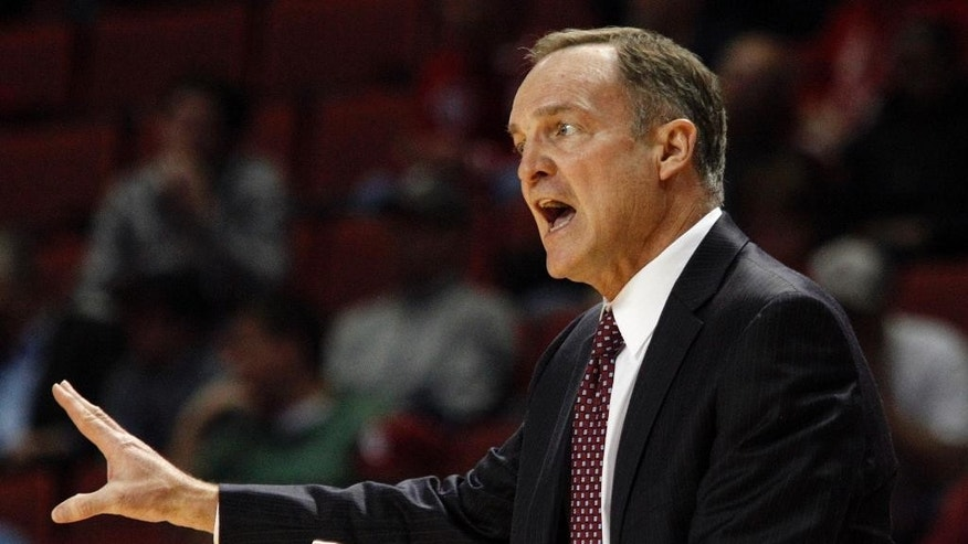 Oklahoma head coach Lon Kruger reacts to an official's call during an NCAA game between Oklahoma and West Virginia at the Lloyd Noble Center in Norman, Okla., Wednesday, March 5, 2014. (AP Photo/Garett Fisbeck)