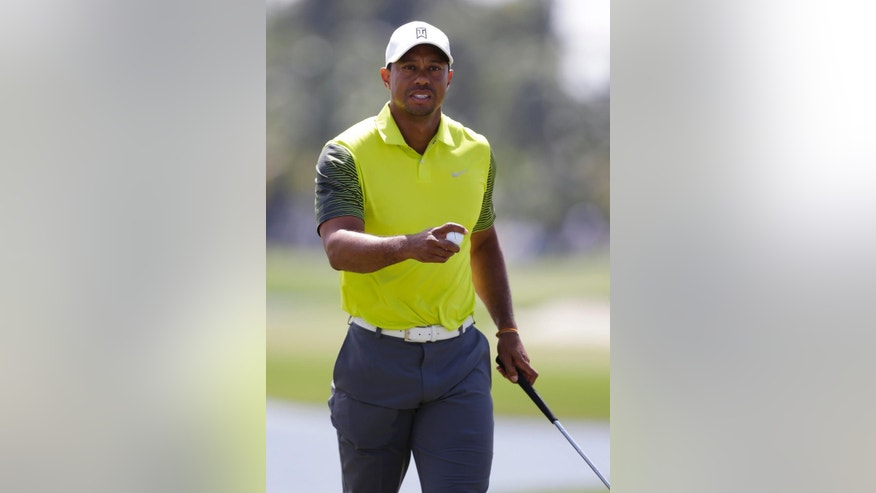 Tiger Woods holds the ball ball after making par on the 10th hole during the second round of the Cadillac Championship golf tournament Friday, March 7, 2014, in Doral, Fla. (AP Photo/Wilfredo Lee)