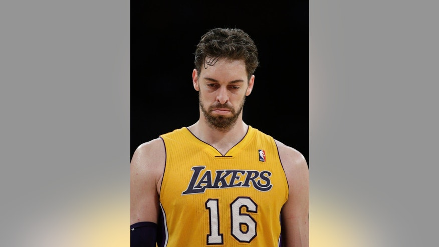 Los Angeles Lakers' Pau Gasol, of Spain, walks down the court during the first half of an NBA basketball game against the Los Angeles Clippers on Thursday, March 6, 2014, in Los Angeles. (AP Photo/Jae C. Hong)