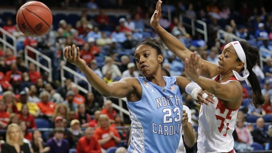 North Carolina's Diamond DeShields (23) is fouled by Maryland's Laurin Mincy (1) during the first half of an NCAA college basketball game at the Atlantic Coast Conference tournament in Greensboro, N.C., Friday, March 7, 2014. (AP Photo/Chuck Burton)
