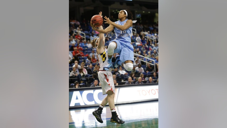 North Carolina's Danielle Butts (10) drives past Maryland's Katie Rutan during the first half of an NCAA college basketball game at the Atlantic Coast Conference tournament in Greensboro, N.C., Friday, March 7, 2014. (AP Photo/Chuck Burton)