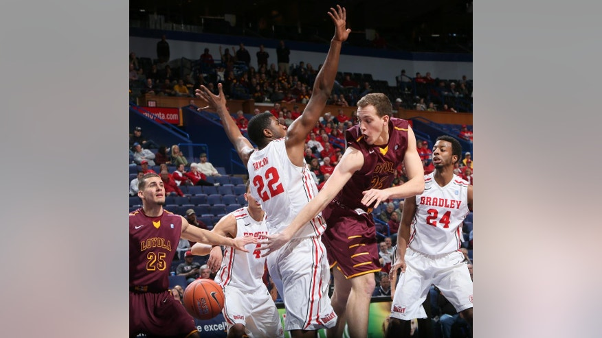 Loyola of Chicago forward Matt O'Leary passes the ball around Bradley's Xzavier Taylor during the second half of an NCAA college basketball game in the Missouri Valley Conference men's tournament, Thursday, March 6, 2014, in St. Louis. (AP Photo/St. Louis Post-Dispatch, Chris Lee) EDWARDSVILLE OUT  ALTON OUT