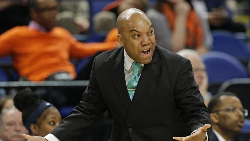 Syracuse head coach Quentin Hillsman reacts to a call during the first half of an NCAA college basketball game against North Carolina State at the Atlantic Coast Conference tournament in Greensboro, N.C., Friday, March 7, 2014. (AP Photo/Chuck Burton)
