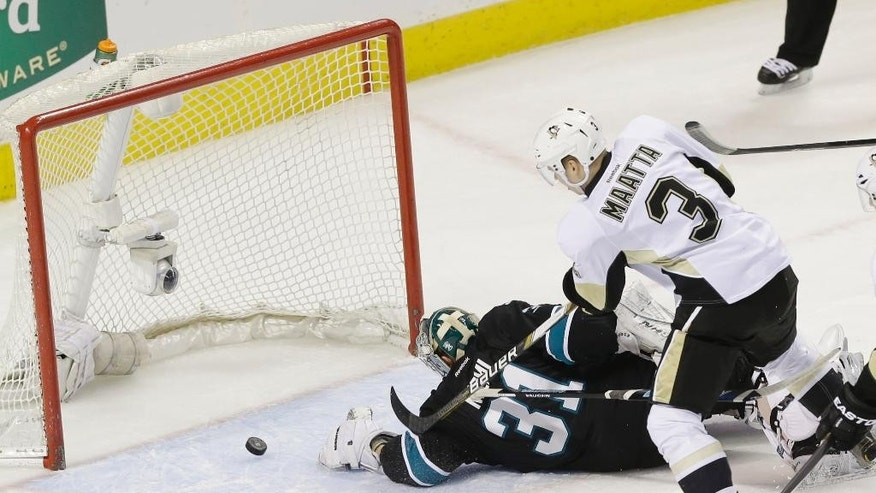 Pittsburgh Penguins' Olli Maatta (3), of Finland, scores past San Jose Sharks goalie Antti Niemi (31), of Finland, during the first period of an NHL hockey game on Thursday, March 6, 2014, in San Jose, Calif. (AP Photo/Marcio Jose Sanchez)
