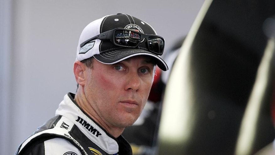 Kevin Harvick works in the garage during NASCAR Sprint Cup auto racing practice on Friday, March 7, 2014, in Las Vegas. (AP Photo/Isaac Brekken)
