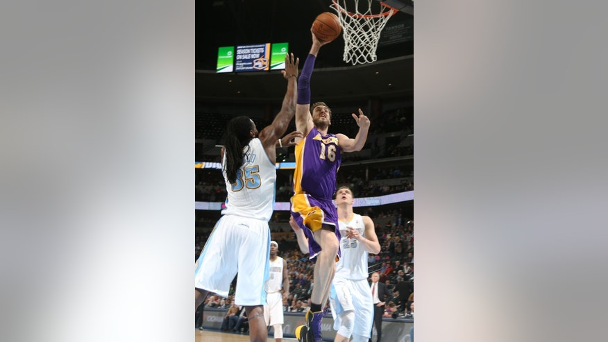 Los Angeles Lakers center Pau Gasol, center, of Spain, drives the lane for a shot as Denver Nuggets forward Kenneth Faried, left, and center Timofey Mozgov, of Russia, cover in the first quarter of an NBA basketball game in Denver on Friday, March 7, 2014. (AP Photo/David Zalubowski)