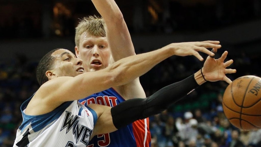 Detroit Pistons' Kyle Singler, right, causes Minnesota Timberwolves' Kevin Martin  to lose the ball in the first quarter of an NBA basketball game, Friday, March 7, 2014, in Minneapolis. (AP Photo/Jim Mone)