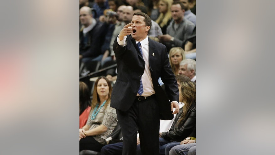 Detroit Pistons head coach John Loyer yells instructions in the first quarter of an NBA basketball game against the Minnesota Timberwolves, Friday, March 7, 2014, in Minneapolis. (AP Photo/Jim Mone)