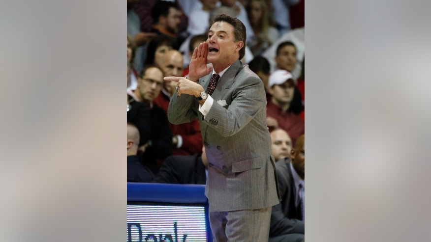 Louisville coach Rick Pitino yells instructions to the team during the first half of an NCAA college basketball game against SMU on Wednesday, March 5, 2014, in Dallas. Pitino has ashes on his forehead for Ash Wednesday. (AP Photo/John F. Rhodes)