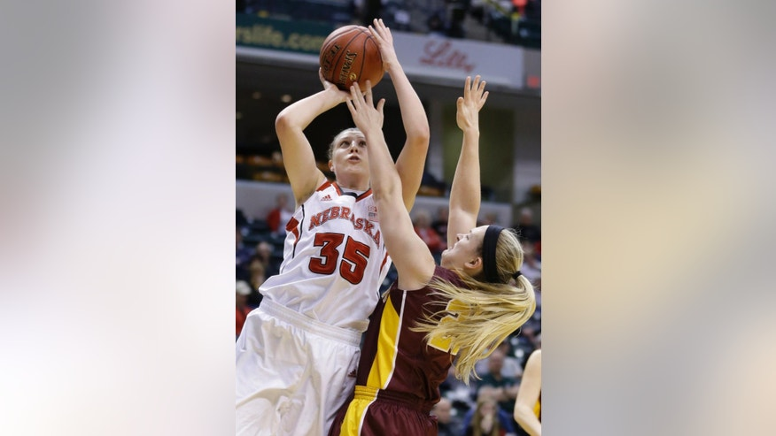 Nebraska forward Jordan Hooper, left, shoots over Minnesota guard Sari Noga in the first half of an NCAA college basketball game in the quarterfinals of the Big Ten women's tournament in Indianapolis, Friday, March 7, 2014. (AP Photo/Michael Conroy)