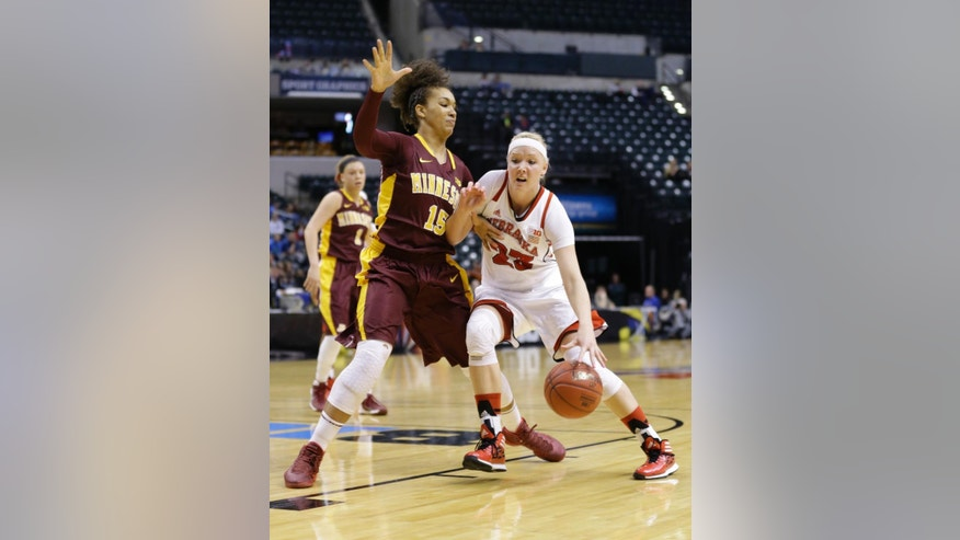 Nebraska forward Emily Cady, right, drives on Minnesota forward Micaella Riche in the first half of an NCAA college basketball game in the quarterfinals of the Big Ten women's tournament in Indianapolis, Friday, March 7, 2014. (AP Photo/Michael Conroy)