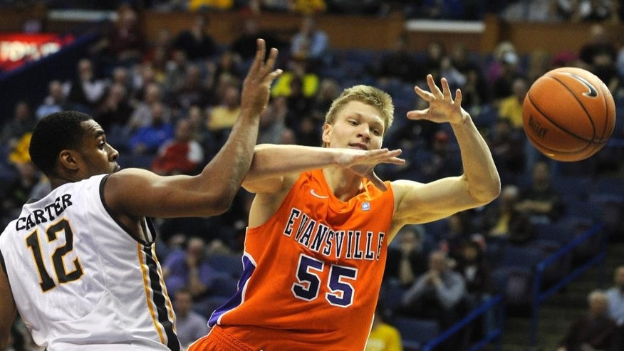 Wichita State's Darius Carter (12) and Evansville's Egidijus Mockevicius (55) reach for the ball in the first half of an NCAA college basketball game in the quarterfinals of the Missouri Valley Conference tournament, Friday, March 7, 2014  in St. Louis. (AP Photo/Bill Boyce)