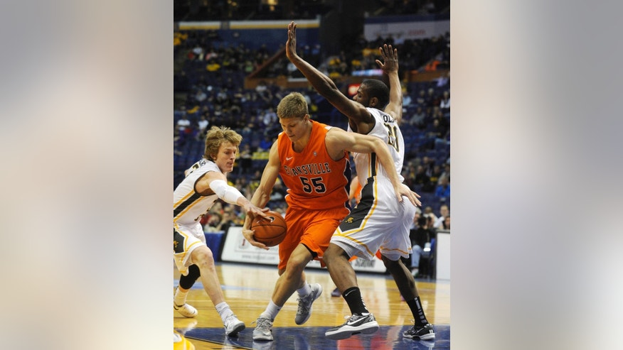 Evansville's Egidijus Mockevicius (55) drives through Wichita State's Ron Baker left, and  Kadeem Coleby, in the first half of an NCAA college basketball game in the quarterfinals of the Missouri Valley Conference  Friday, March 7, 2014  in St. Louis. (AP Photo/Bill Boyce)