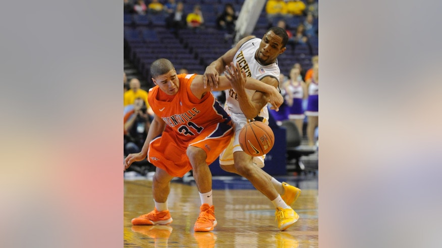 Evansville's D.J. Balentine (31) and Wichita State's Takele Cotton, right, reach for the ball in the first half of an NCAA college basketball game in the quarterfinals of the Missouri Valley Conference tournament, Friday, March 7, 2014  in St. Louis. (AP Photo/Bill Boyce)