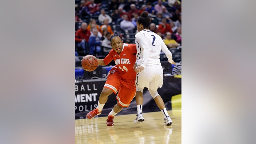 Ohio State guard Ameryst Alston, left, drives on Penn State guard Dara Taylor in the second half of an NCAA college basketball game in the quarterfinals of the Big Ten women's tournament in Indianapolis, Ind., Friday, March 7, 2014. Ohio State defeated Penn State 99-82. (AP Photo/Michael Conroy)