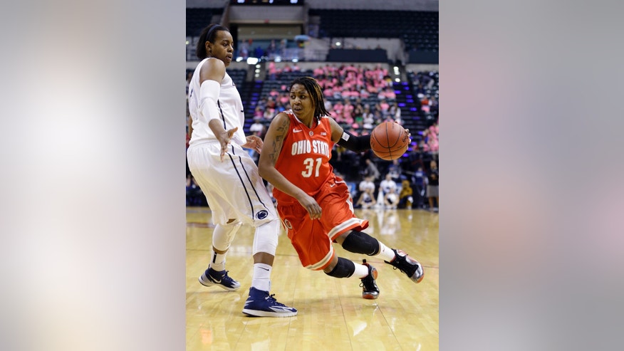 Ohio State guard Raven Ferguson, right, drives on Penn State forward Talia East in the second half of an NCAA college basketball game in the quarterfinals of the Big Ten women's tournament in Indianapolis, Ind., Friday, March 7, 2014. Ohio State defeated Penn State 99-82. (AP Photo/Michael Conroy)