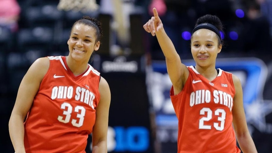 Ohio State center Ashley Adams, left, and forward Martina Ellerbe celebrate in the closing seconds against Penn State in the second half of an NCAA college basketball game in the quarterfinals of the Big Ten women's tournament in Indianapolis, Ind., Friday, March 7, 2014. Ohio State defeated Penn State 99-82. (AP Photo/Michael Conroy)