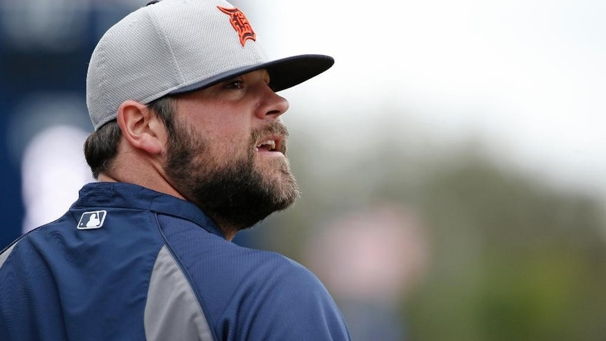 Detroit Tigers relief pitcher Joba Chamberlain looks over his shoulder at former New York Yankees teammates before a spring training baseball game against the New York Yankees in Tampa, Fla., Friday, March 7, 2014. Chamberlain is scheduled to pitch in relief against his former team Friday. (AP Photo/Kathy Willens)