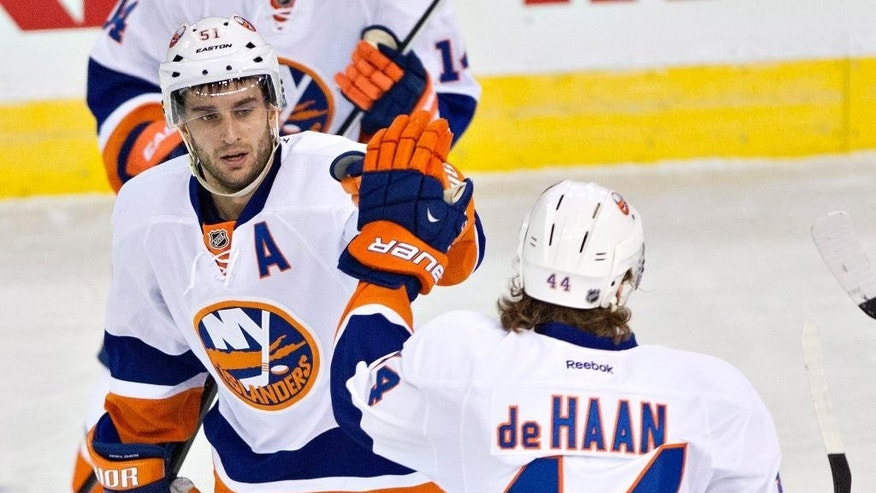 New York Islanders' Frans Nielsen (51) and Calvin de Haan (44) celebrate a goal against the Edmonton Oilers during the first period of an NHL hockey game in Edmonton, Alberta, on Thursday, March 6, 2014. (AP Photo/The Canadian Press, Jason Franson)