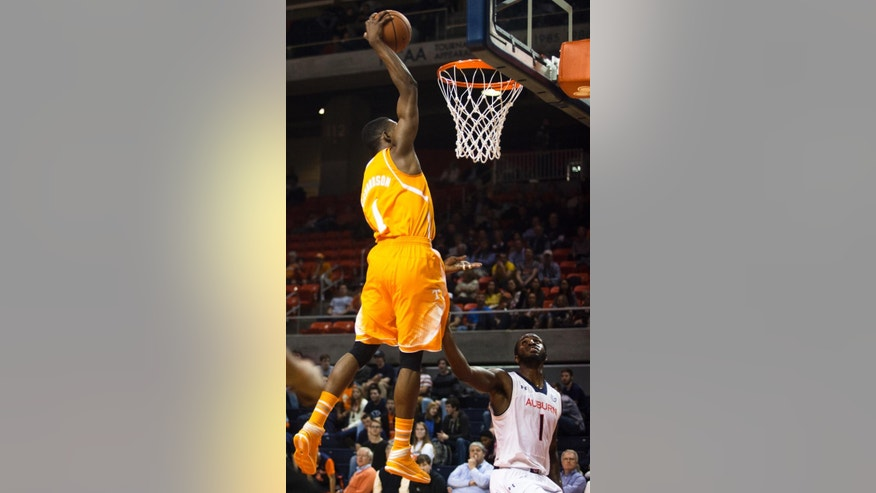 Tennessee guard Josh Richardson (1) dunks over Auburn guard KT Harrell (1) during the second half of an NCAA college basketball game Wednesday, March 5, 2014, at Auburn Arena in Auburn, Ala. Tennessee defeated Auburn 82-54. (AP Photo/Opelika-Auburn News, Albert Cesare)