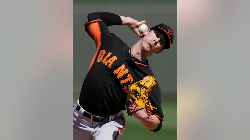 San Francisco Giants' Tim Lincecum delivers to the Kansas City Royals in the second inning of a spring training baseball game on Friday, March 7, 2014, in Surprise, Ariz. (AP Photo/Tony Gutierrez)