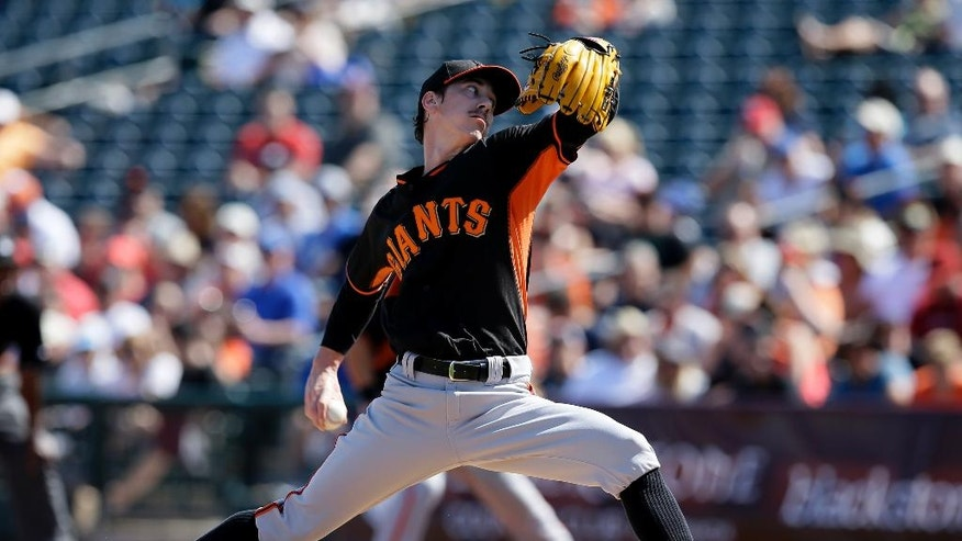 San Francisco Giants' Tim Lincecum works against the Kansas City Royals in the first inning of a spring training baseball game, Friday, March 7, 2014, in Surprise, Ariz. (AP Photo/Tony Gutierrez)