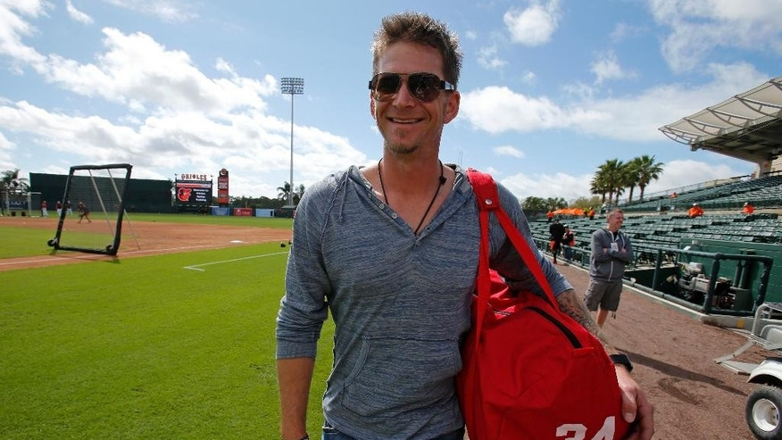 Philadelphia Phillies starting pitcher A.J. Burnett arrives at Ed Smith Stadium for an exhibition spring training baseball game against the Baltimore Orioles in Sarasota, Fla., Friday, March 7, 2014. Burnett is scheduled to start the game. (AP Photo/Gene J. Puskar)