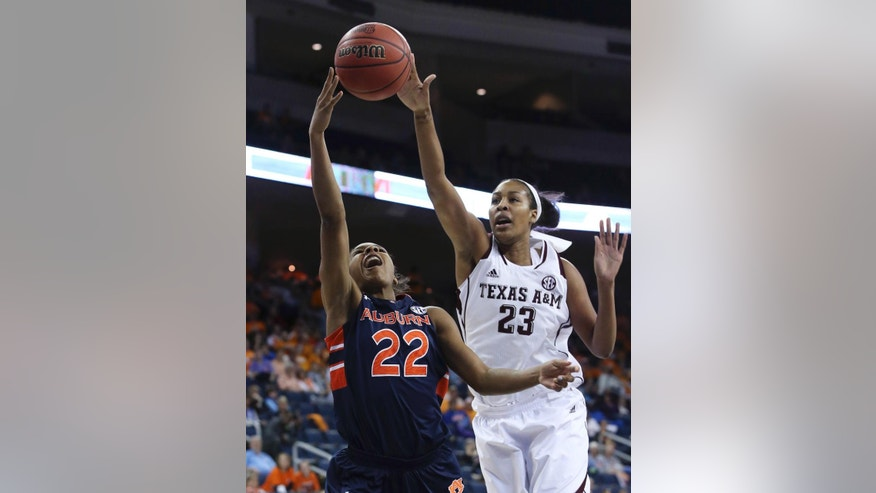 Auburn guard Kiani Parker (22) goes up for a basket against Texas A&M center Rachel Mitchell (23) during the first half in an NCAA college basketball game in the quarterfinals of the Southeastern Conference women's tournament, Friday, March 7, 2014, in Duluth, Ga. (AP Photo/Jason Getz)