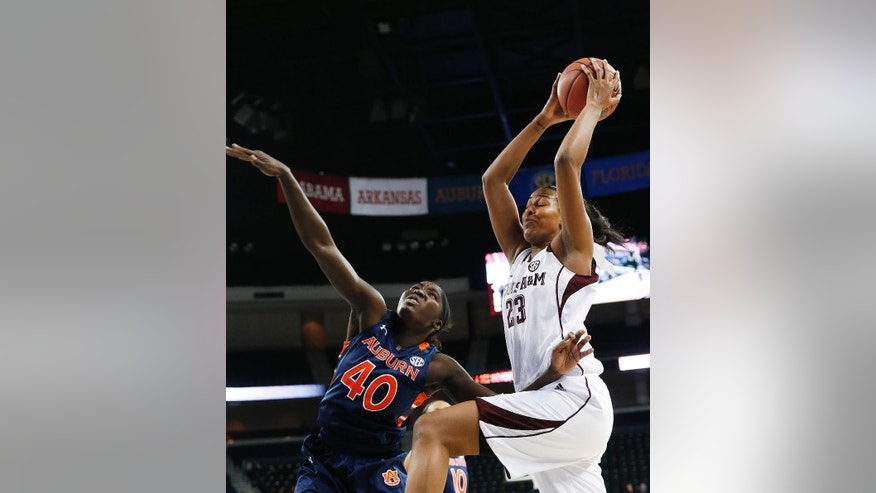 Texas A&M center Rachel Mitchell (23) goes up for a shot as Auburn guard Khady Dieng (40) defends during the first half in an NCAA college basketball game in the quarterfinals of the Southeastern Conference women's tournament, Friday, March 7, 2014, in Duluth, Ga. (AP Photo/John Bazemore)